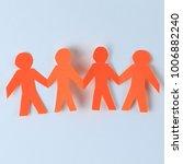four paper men taking each... | Shutterstock . vector #1006882240