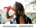 Woman Traveler Drinking Water