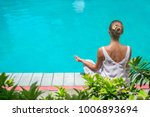 young woman in a lotus pose by... | Shutterstock . vector #1006893694