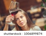 young girl with a wine glass in ... | Shutterstock . vector #1006899874