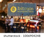 Small photo of sign bitcoin accepted here hanging in front of restaurant door. bitcoin , electronic money concept