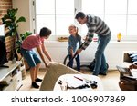 kids helping house chores | Shutterstock . vector #1006907869