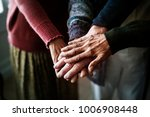 closeup of hands of group of... | Shutterstock . vector #1006908448