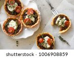 caramelised onion, goats cheese, cherry tomato and thyme tartlets