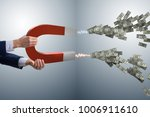 businessman catching dollars on ... | Shutterstock . vector #1006911610