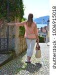 girl on the cobbled street of... | Shutterstock . vector #1006915018