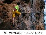 female rock climber climbing on ... | Shutterstock . vector #1006918864