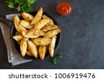 baked potato wedges with cheese ... | Shutterstock . vector #1006919476