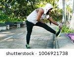 african descent man stretching...   Shutterstock . vector #1006921738