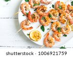 grilled shrimp skewers. seafood ... | Shutterstock . vector #1006921759