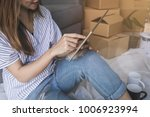 young happy woman moving in new ... | Shutterstock . vector #1006923994