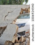 a white car under wall ruin | Shutterstock . vector #1006924540