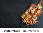 grilled shrimp skewers. seafood ... | Shutterstock . vector #1006924849