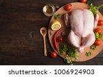 raw whole chicken on wooden... | Shutterstock . vector #1006924903