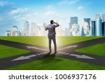 young businessman at crossroads ... | Shutterstock . vector #1006937176