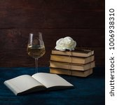 Small photo of Books Are Knitted by the Jigut Rope, Rosebud, Glass with White Wine and the Open Book.
