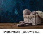 light gray knits in a basket... | Shutterstock . vector #1006941568