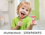 happy kid boy brushing teeth... | Shutterstock . vector #1006960693
