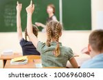 school children in classroom at ... | Shutterstock . vector #1006960804