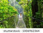 hiking in green tropical jungle ... | Shutterstock . vector #1006962364