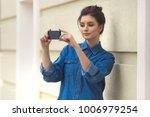 stylish beautiful woman in...   Shutterstock . vector #1006979254