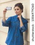 stylish beautiful woman in...   Shutterstock . vector #1006979260