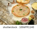 delicious pizza with cheese and ... | Shutterstock . vector #1006991140