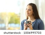portrait of a satisfied woman... | Shutterstock . vector #1006995703