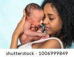 loving african mother holding... | Shutterstock . vector #1006999849