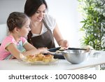 mother and daughter with cookie ... | Shutterstock . vector #1007008840