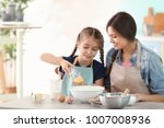 mother and daughter preparing... | Shutterstock . vector #1007008936