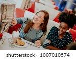 multiracial female friends... | Shutterstock . vector #1007010574