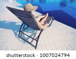 young woman in hat lying on a... | Shutterstock . vector #1007024794