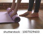 a barefoot woman twists a... | Shutterstock . vector #1007029603