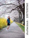 happy woman enjoying nature....   Shutterstock . vector #1007030560