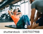 personal trainer assisting... | Shutterstock . vector #1007037988