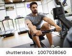 young handsome man doing... | Shutterstock . vector #1007038060