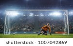 soccer goalkeeper in action on... | Shutterstock . vector #1007042869