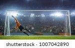 soccer goalkeeper in action on... | Shutterstock . vector #1007042890