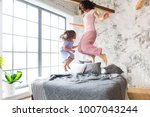 family fun. mother and daughter ... | Shutterstock . vector #1007043244
