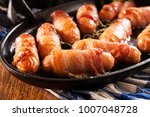 pigs in blankets. mini sausages ... | Shutterstock . vector #1007048728