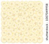 background of sliced banana.... | Shutterstock .eps vector #1007049958