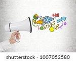 man s hand holding a megaphone... | Shutterstock . vector #1007052580