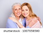 Small photo of Mum mom mama mommy grandma granny concept care trust home comfort concept. Close up portrait of charming cheerful calm peaceful hugging daughter and mother isolated on gray background