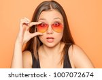 young strartled girl with... | Shutterstock . vector #1007072674