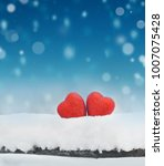 red heart on snow background.... | Shutterstock . vector #1007075428