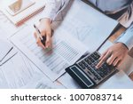 businessman using calculator... | Shutterstock . vector #1007083714