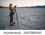 young female photographer shoot ... | Shutterstock . vector #1007084560