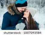 walk in winter. young happy... | Shutterstock . vector #1007093584