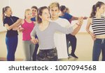smiling boys and girls dancing... | Shutterstock . vector #1007094568